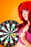 Dartboard Girl 3. Teenage girl holding a dartboard with multiple darts in it. Other hand holding a single dart royalty free stock images