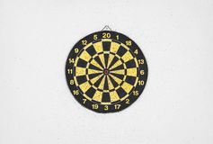 Dartboard on gray wall. Background Stock Photography
