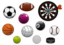 Dartboard, hockey puck and sports balls Royalty Free Stock Photo