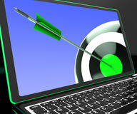 Dartboard On Laptop Showing Precise Aiming. And Accurate Targeting Stock Photos