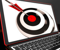 Dartboard On Laptop Shows Effectiveness. And Accuracy Royalty Free Stock Photos