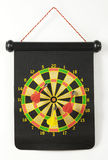 Dartboard with magnetic darts Stock Images