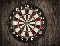 Dartboard on old wooden wall. Stock Images