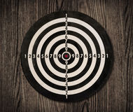 Dartboard On Wooden Wall, Clipping Path. Stock Image