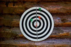Dartboard on ooden wall Stock Image