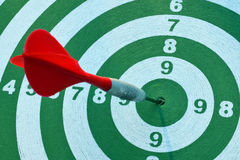 Dartboard with a red dart. In the center Royalty Free Stock Photo