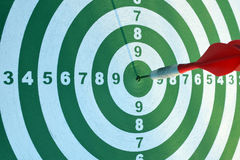 Dartboard with a red dart. In the center Stock Photography