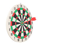 Dartboard with red dart at the center on white Royalty Free Stock Photography