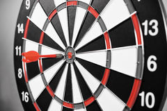 Dartboard with red darts Stock Image