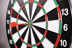 Dartboard with red darts Stock Photography