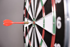 Dartboard with red darts Royalty Free Stock Photography