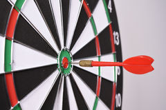 Dartboard with red darts Stock Images