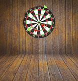 Dartboard on room wood Stock Images