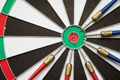 Dartboard. Six darts on the target center of dartboard Stock Photography
