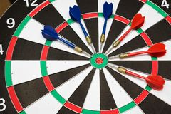 Dartboard. Six darts on the target center of dartboard Stock Images