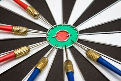 Dartboard. Six darts on the target center of dartboard Royalty Free Stock Photo