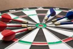 Dartboard. Six darts on the target center of dartboard Stock Photo