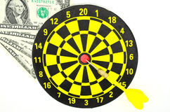 Dartboard and some mone. Y on white background, could be concept for success royalty free stock images