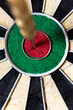 Dartboard with Steel darts in bullseye Stock Image