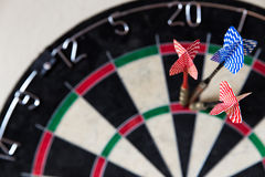 Dartboard with Steel-darts in it Royalty Free Stock Photos