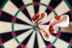 Dartboard with Steel-darts and euro in it Stock Images