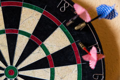 Dartboard with Steel darts outside Stock Photography