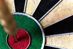 Dartboard with Steeldarts in bullseye Stock Image
