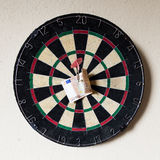 Dartboard with Steeldarts and euro in it Royalty Free Stock Image