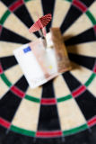Dartboard with Steeldarts and euro in it. Closeup of a Dartboard with Steeldarts and euro in it Stock Photo