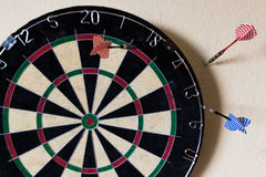 Dartboard with Steeldarts in the wall Stock Photos