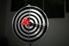 Trying to hit the dartboard stock photo