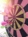 Dartboard is the target and Dart is an opportunity blur Stock Image