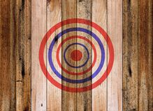Dartboard target on old wooden wall Royalty Free Stock Photos