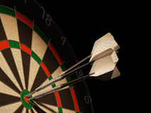 Dartboard with three darts in center target. Dartboard with three darts in center target, with blank tails Stock Photography