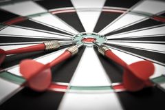 Dartboard. Three darts on the target center of dartboard Stock Photography