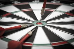 Dartboard. Three darts on the target center of dartboard Stock Photo