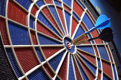 Dartboard and two arrows in the center. Close-up Stock Photo
