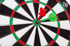 Dartboard. With two darts closeup Royalty Free Stock Photography