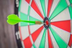 Dartboard on wood (Darts Hit Target) Stock Photo