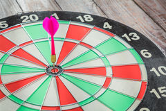 Dartboard on wood  (Darts Hit Target) Royalty Free Stock Images