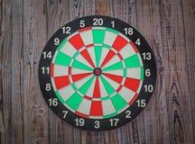 Dartboard on wood (Darts Hit Target) Royalty Free Stock Image