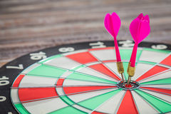 Dartboard on wood  (Darts Hit Target) Royalty Free Stock Photography