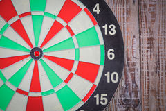 Dartboard on wood wall Stock Image