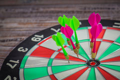 Dartboard on wood wall background (miss darts) Royalty Free Stock Images