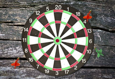 Dartboard on wood wall Royalty Free Stock Photo
