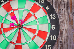 Dartboard on wood wall Stock Images