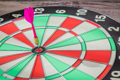 Dartboard on wood wall Royalty Free Stock Images