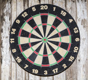 Dartboard on wooden painted background Stock Images