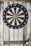 Dartboard on wooden painted door background Stock Photos