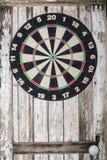 Dartboard on wooden painted door background Stock Photos